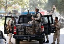 Afghan security forces leave the site of a suicide attack followed by a clash between Afghan forces and insurgents after the attack on Iraq embassy in Kabul, Afghanistan