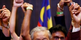 Mahathir Mohamad reacts during a news conference after general election, in Petaling Jaya
